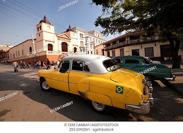 Old american cars at the Square of Plaza Dolores, Santiago, Santiago de Cuba, Cuba. Antilles, Central America