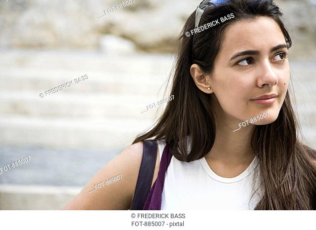 A young woman looking away in contemplation