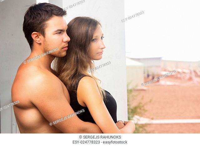 Summer, sea. Attractive couple on the beach