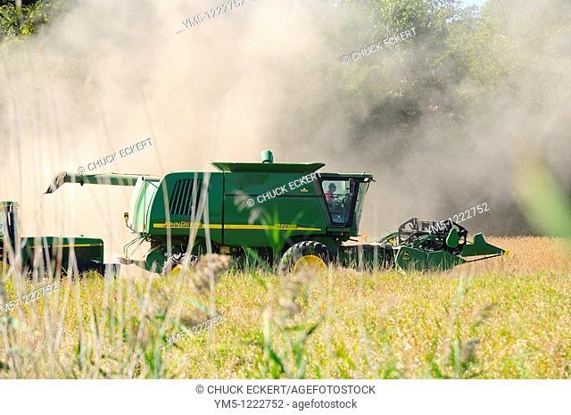 John Deere combine harvesting field grain