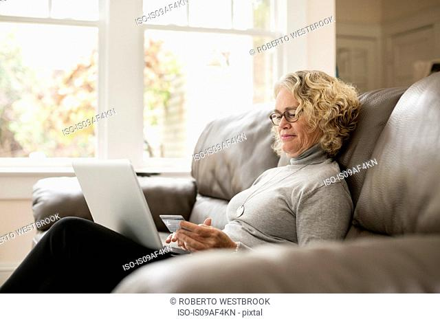 Senior woman shopping online on laptop