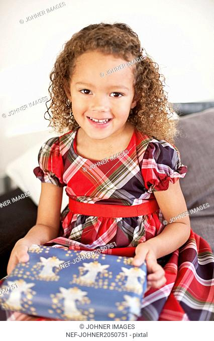 Portrait of girl with Christmas present