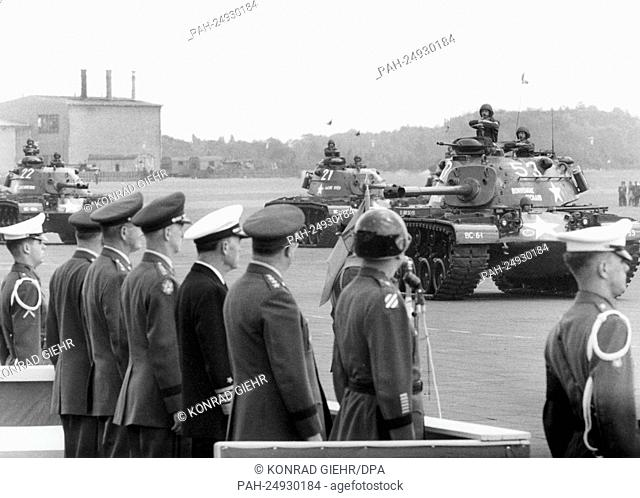 Tanks of the US Army driving past a VIP stand with US generals and commander-in-chiefs as a part of a military parade for the 'Armed Forces Day' on 21st May...