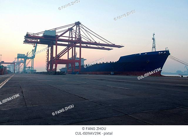 Container ship and cranes at port