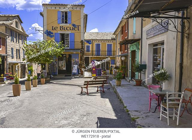 square and colourful houses of the village Banon, Provence, France, department Alpes-de-Haute-Provence