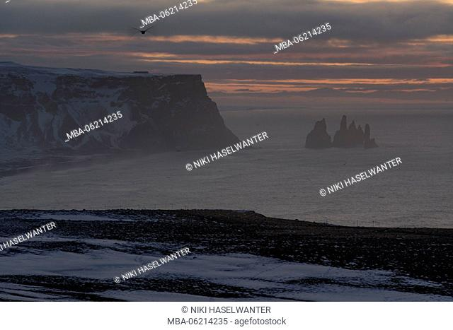 Morning mood at Dyrholaey on Iceland with Reynisdrangar rocks in the background