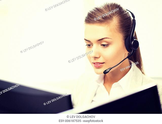 picture of friendly female helpline operator with headphones