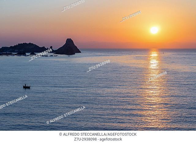 The sunset on the sea of Taormina (Italy)