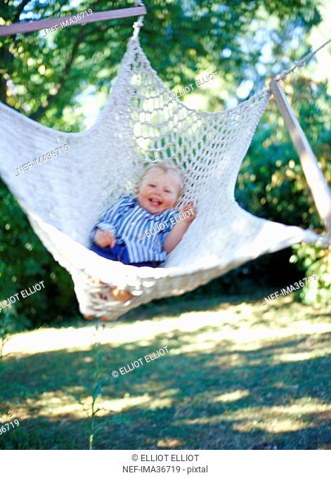 A girl swinging in a hammock