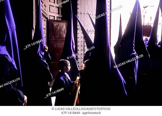 Penitents  Good Friday In Santo domingo church  Brotherhood of `Soledad Campo Principe'  Granada  Andalusia, Spain