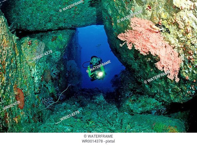 Diver in Cave, Similan Islands, Thailand