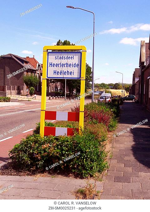 Signs letting you know what neighbouhood you are entering are usually written in both Dutch and the local dialect
