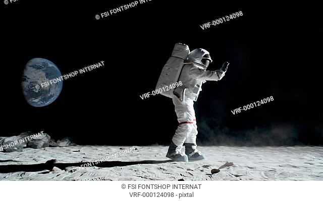 SLO MO, WS lockdown of an astronaut doing the moonwalk and dancing on the moon