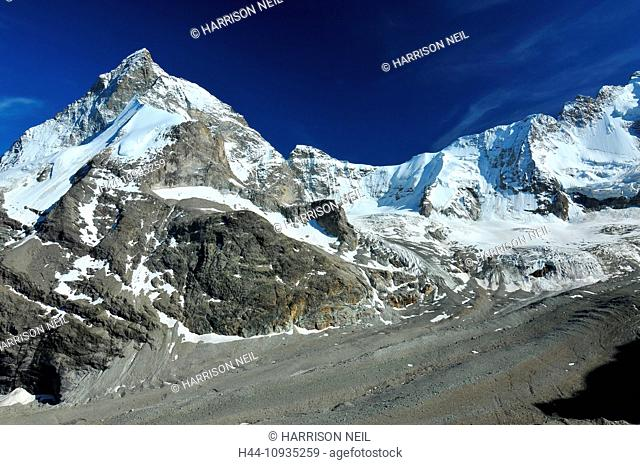 The Matterhorn, L, and the Dent d'Herens, R, above the Zmutt glacier in the southern swiss alps above Zermatt