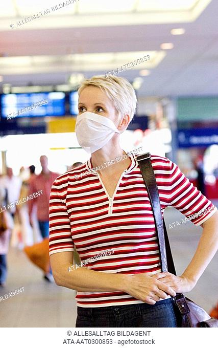 Woman with surgical mask in public