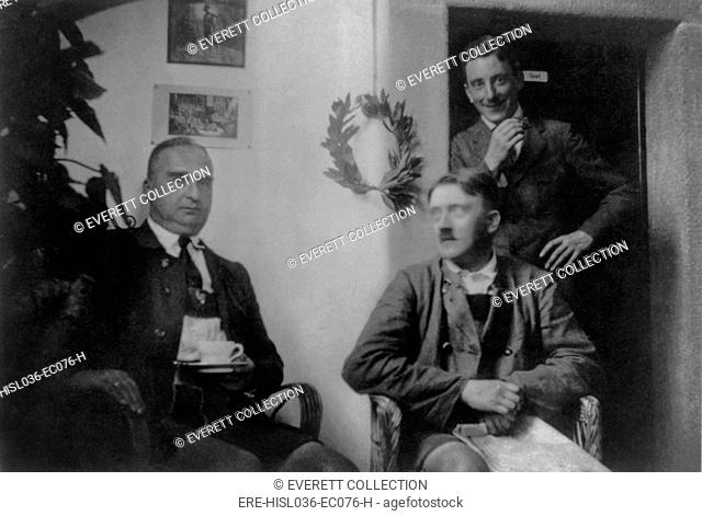 Adolf Hitler with visitors while serving his sentence for in Landsberg Prison. Standing behind Hitler is Emil Maurice, early member of the Nazi Party and one of...