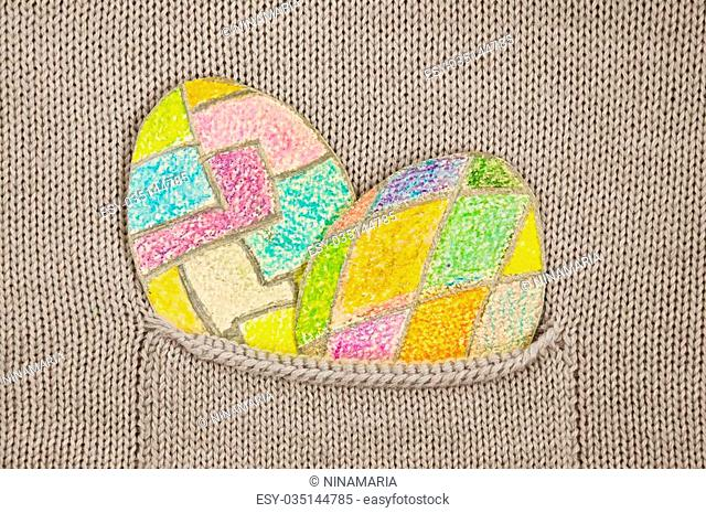 painted colorful Easter eggs in a knitted jacket pocket. I myself drew these pictures