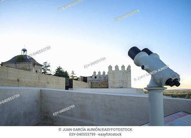 Touristic telescope at Alcazaba of Badajoz, an ancient Moorish citadel, Extremadura, Spain. Sunset