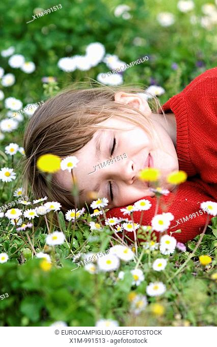Little girl sleeping in meadow