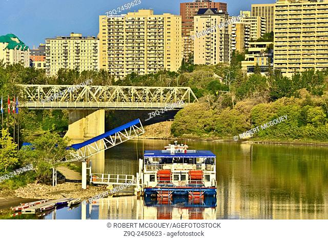 The Edmonton Queen riverboat rests at its dock on the North Saskatchewan River which flows through downtown Edmonton Alberta. Canada