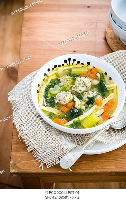 Soup with chicken meatballs, vegetables and pasta