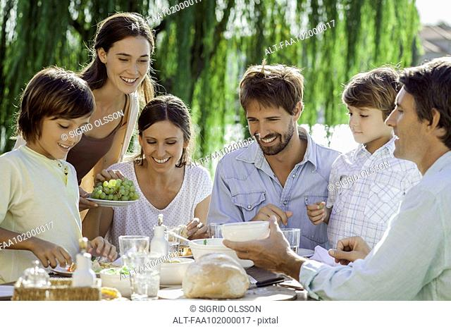 Family enjoying breakfast together outdoors