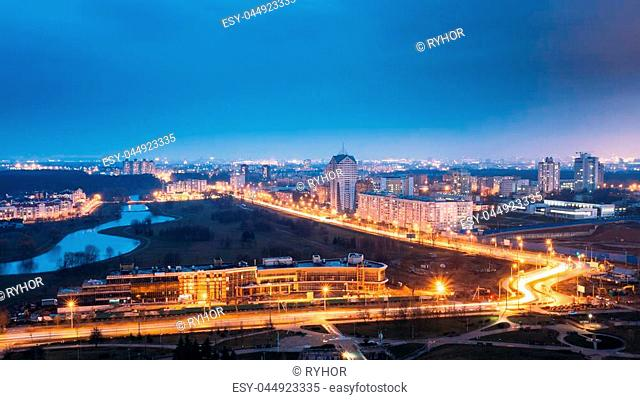 Minsk, Belarus. Panoramic Aerial View Cityscape In Bright Blue Hour Evening And Yellow Illumination Spring Twilight