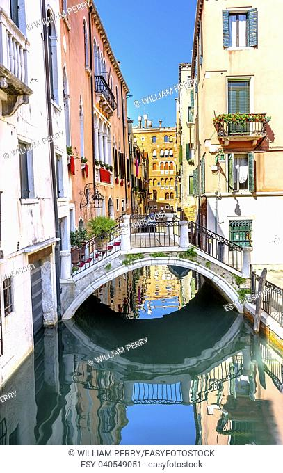 Tourists Colorful Small Canal Bridge Buildings Boats Reflections Venice Italy