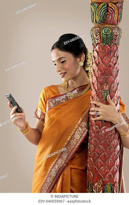South Indian woman looking at her mobile phone