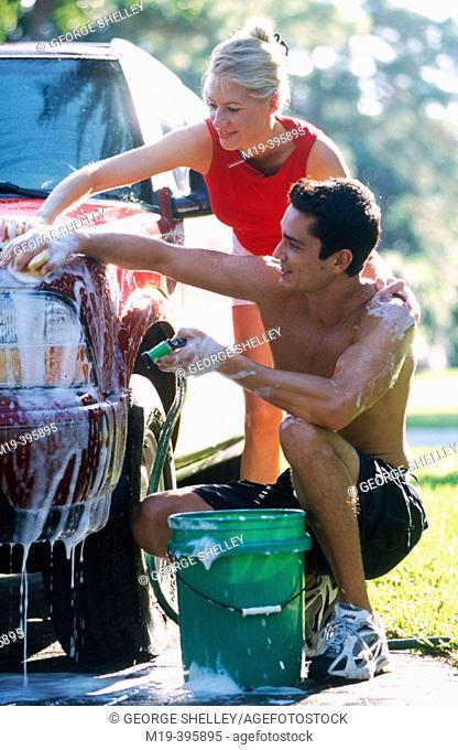 couple washing their car