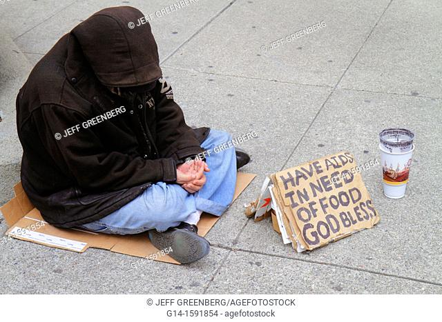 California, San Francisco, Chinatown, Grant Street, homeless, poverty, beggar, vagrant, charity, sign, AIDS, hungry, hooded jacket, sitting on ground, cardboard