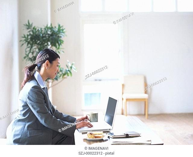 Woman using laptop at table
