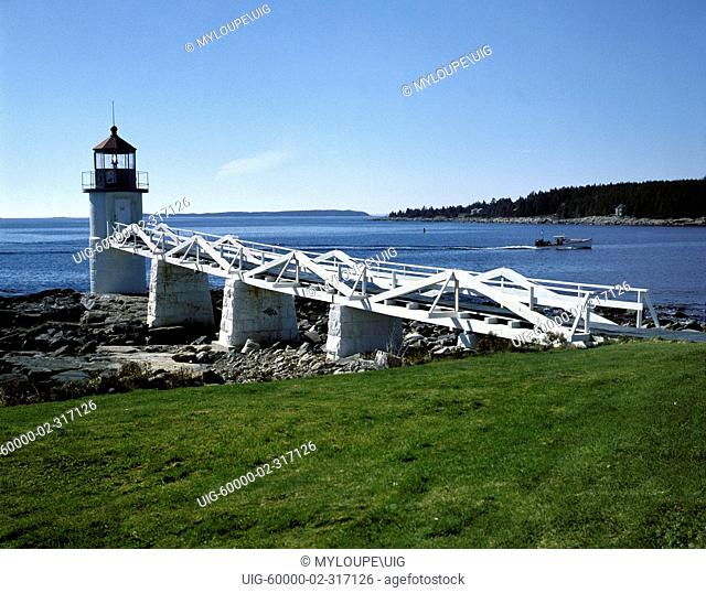 MARSHALL POINT LIGHTHOUSE 1858 with white plank boardwalk serves the fishing village of PORT CLYDE - MAINE