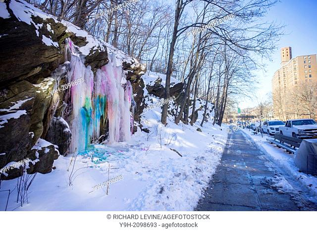 A waterfall comprised of colored icicles is seen on Dyckman Street in Highbridge Park in the Washington Heights neighborhood of New York