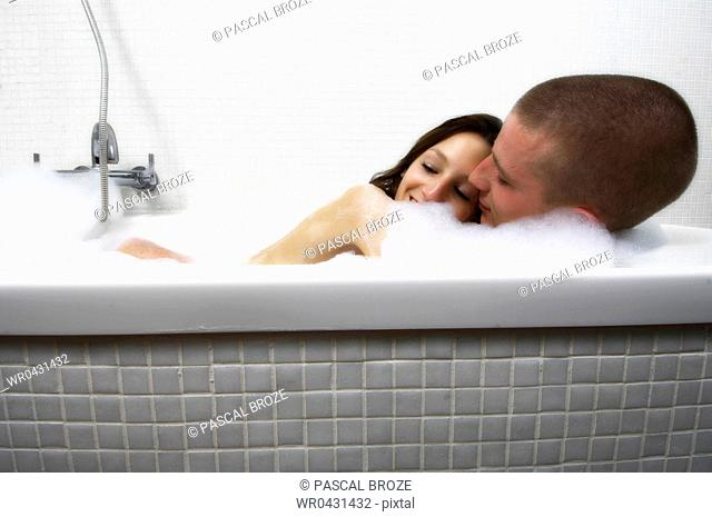 Close-up of a young couple having a bath