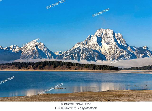 Jackson lake with the Tetons in the background with snow on them