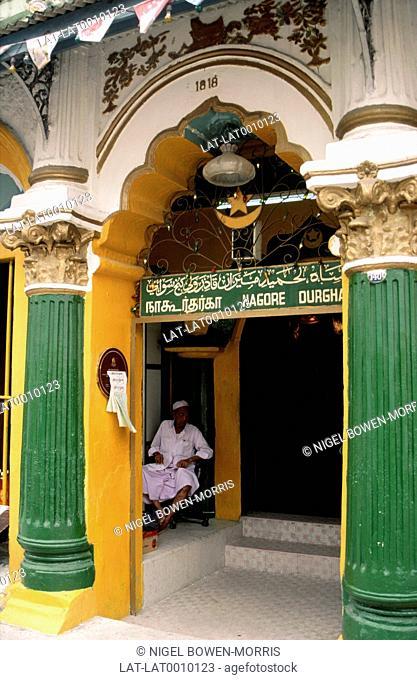 An Indian Muslim Nagore Durgha shrine in Telok Ayer Street,Chinatown. Man in White Robe Sitting