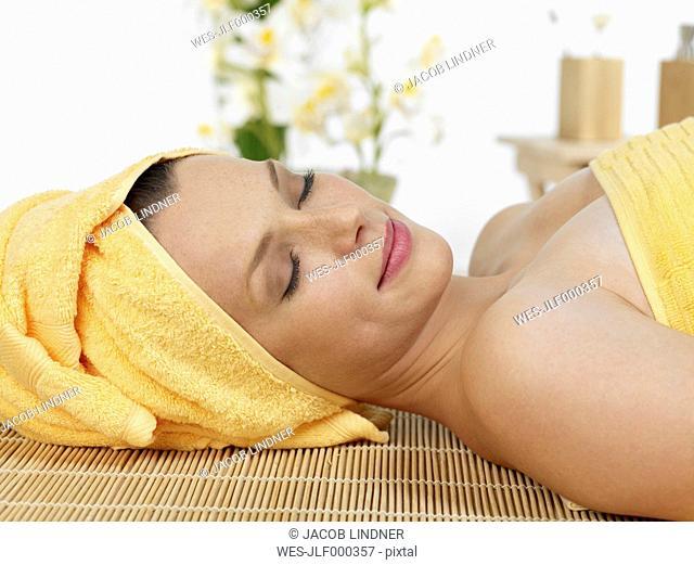 Young woman at spa, smiling