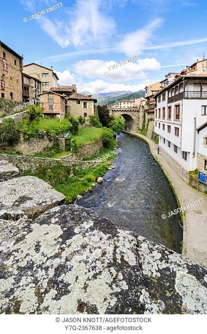 Views over the Rio Quiviesa towards the Puente de la Carcel in Potes Town, Potes, Cantabria, Spain