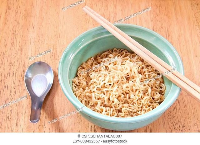 instant noodle with spoon and chopsticks in a ceramic bowl