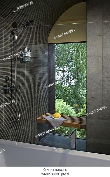 Shower and bench in modern bathroom