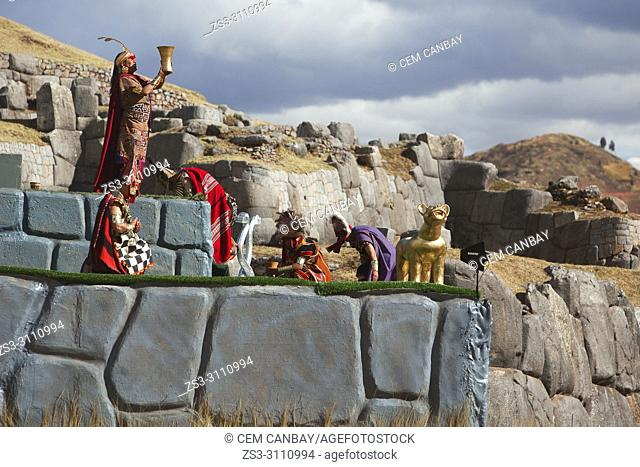 Scene from the Inti Raymi Festival at Saqsaywaman with the representative Inca King offering chicha, the ancient Inca's and todays Peru's local corn-based beer