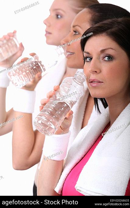 women training and drinking water