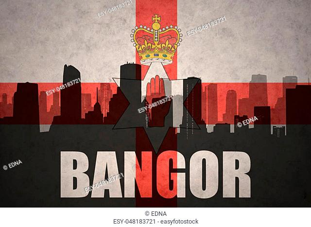 abstract silhouette of the city with text Bangor at the vintage northern ireland flag background