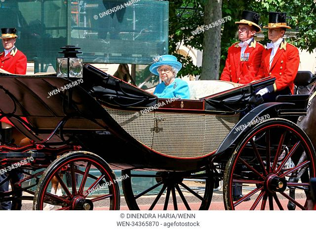 HM The Queen Elizabeth II joined by other members of the Royal Family travel along the Mall in an open top carriage during the Trooping the Colour which marks...