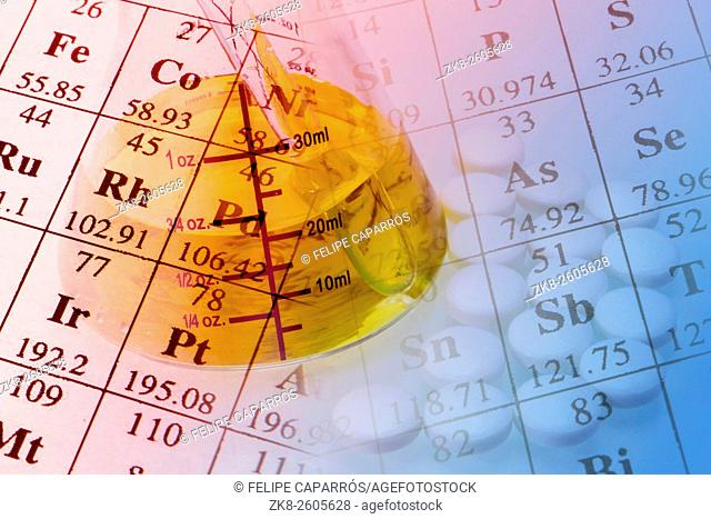 Laboratory glassware and periodic table of elements. Science concept