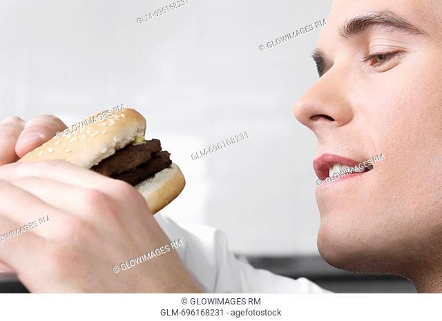 Close-up of a waiter holding a burger