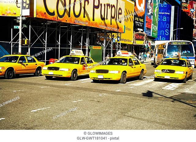 Yellow taxis on a road in a city, Times Square, Manhattan, New York City, New York State, USA