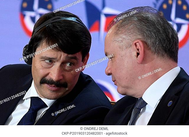 President of Hungary Janos Ader, left, chats with his Slovak counterpart Andrej Kiska as they attend the conference Our Security Is Not Taken For Granted