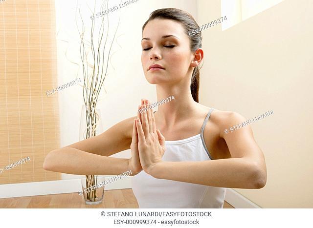 Young woman meditating, close-up